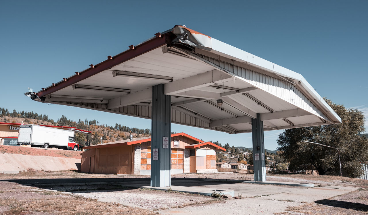 Sorry, we're closed. Abandoned gas station in Flagstaff, Arizona, USA. Abandoned Adventure Architecture Arizona Built Structure Clear Sky Flagstaff, Az Fujifilm Fujinon Gas Station Landscape Landscape_Collection Landscape_photography Nature No People Outdoors Roadtrip Roof Travel Travel Photography USA Vacations Wanderlust Wide Angle X-T10