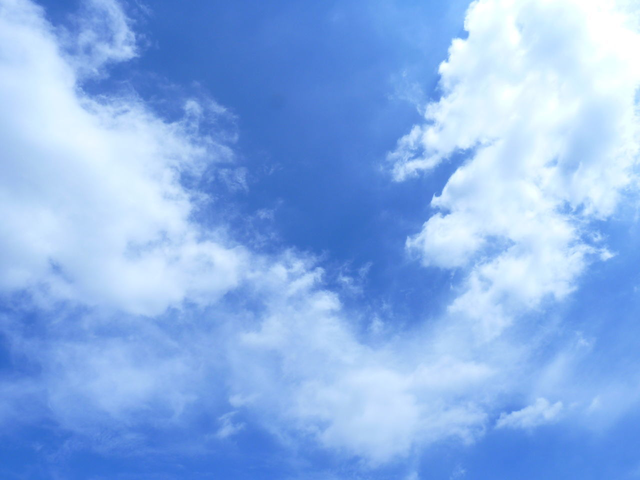 cloud - sky, sky, beauty in nature, nature, blue, low angle view, scenics, tranquility, day, no people, sky only, outdoors, backgrounds, full frame