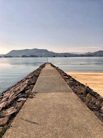 Down On The Beach Water Sky Scenics Tranquil Scene Nature Tranquility No People Day Sea Outdoors Beach Beauty In Nature Groyne Mountain Salt - Mineral Pebble Beach Imari Japan