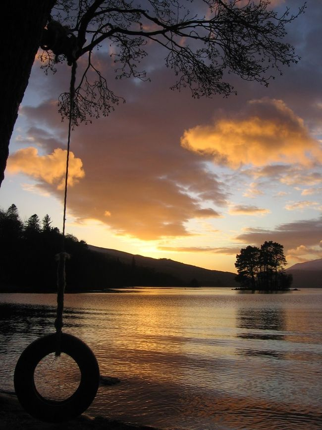 Winter is sunset over Loch Tay in Scotland Sunset Water Tree Tranquil Scene Scenics Tranquility Cloud - Sky Sky Cloud Orange Color Dramatic Sky Nature Atmospheric Mood Beauty In Nature Outdoors Moody Sky Atmosphere No People Majestic Waterfront Scotland Loch Tay Kenmore Swing Eyemphotography