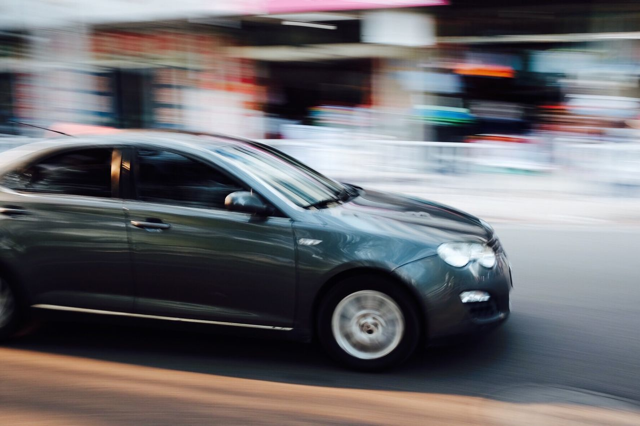 blurred motion, transportation, car, mode of transport, speed, land vehicle, motion, no people, day, road, outdoors