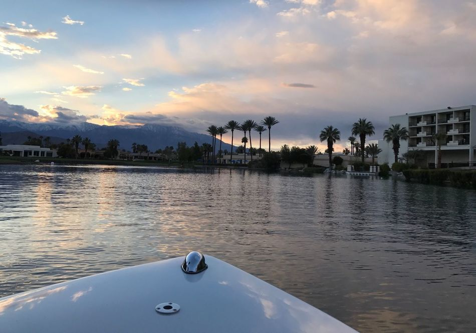 Water And Sky Collection Water And Sky Palm Trees Palm Tree Silhouette Sunset Calmness Waterfront Dusk Colours Boat Ride Boat Palm Desert, CA Tranquil Scene Dusk Sky