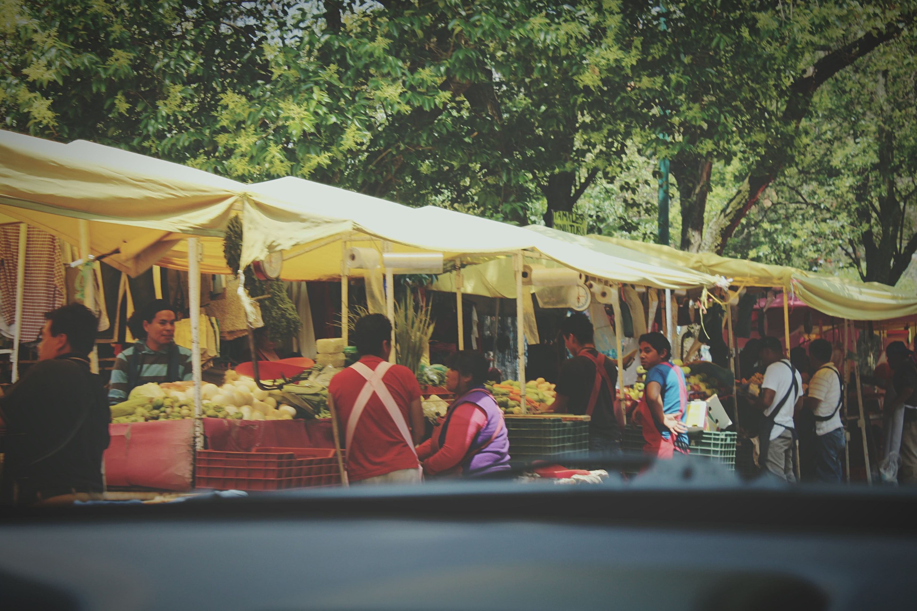 tree, person, men, lifestyles, built structure, table, food and drink, leisure activity, large group of people, architecture, tradition, market stall, incidental people, cultures, day, retail, market, outdoors, culture