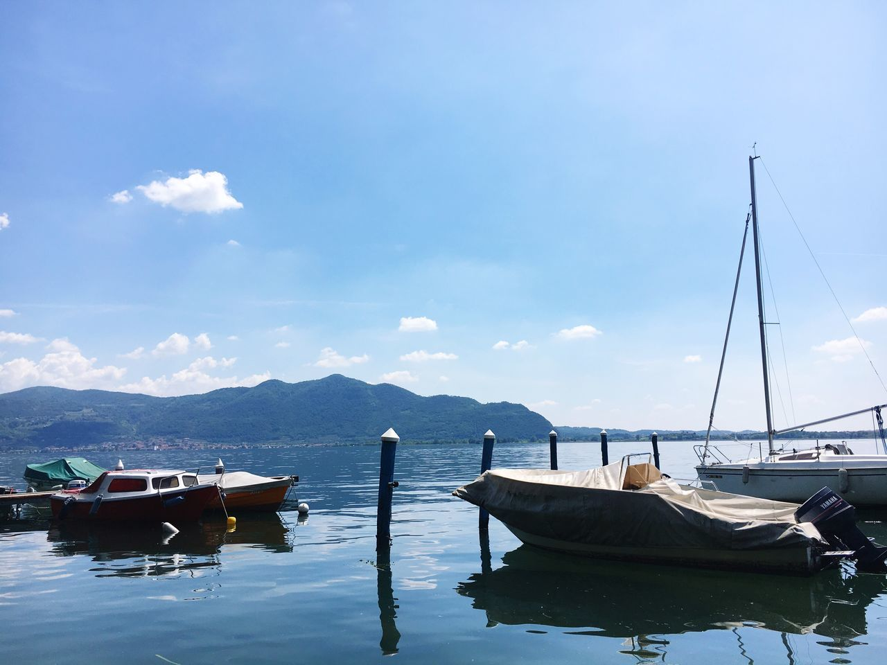 Riva. Nautical Vessel Transportation Mode Of Transport Moored Water Boat Sky Mountain Nature Cloud - Sky No People Day Mountain Range Outdoors Scenics Tranquility Sea Beauty In Nature Mast Lake Old Boat Speedboat