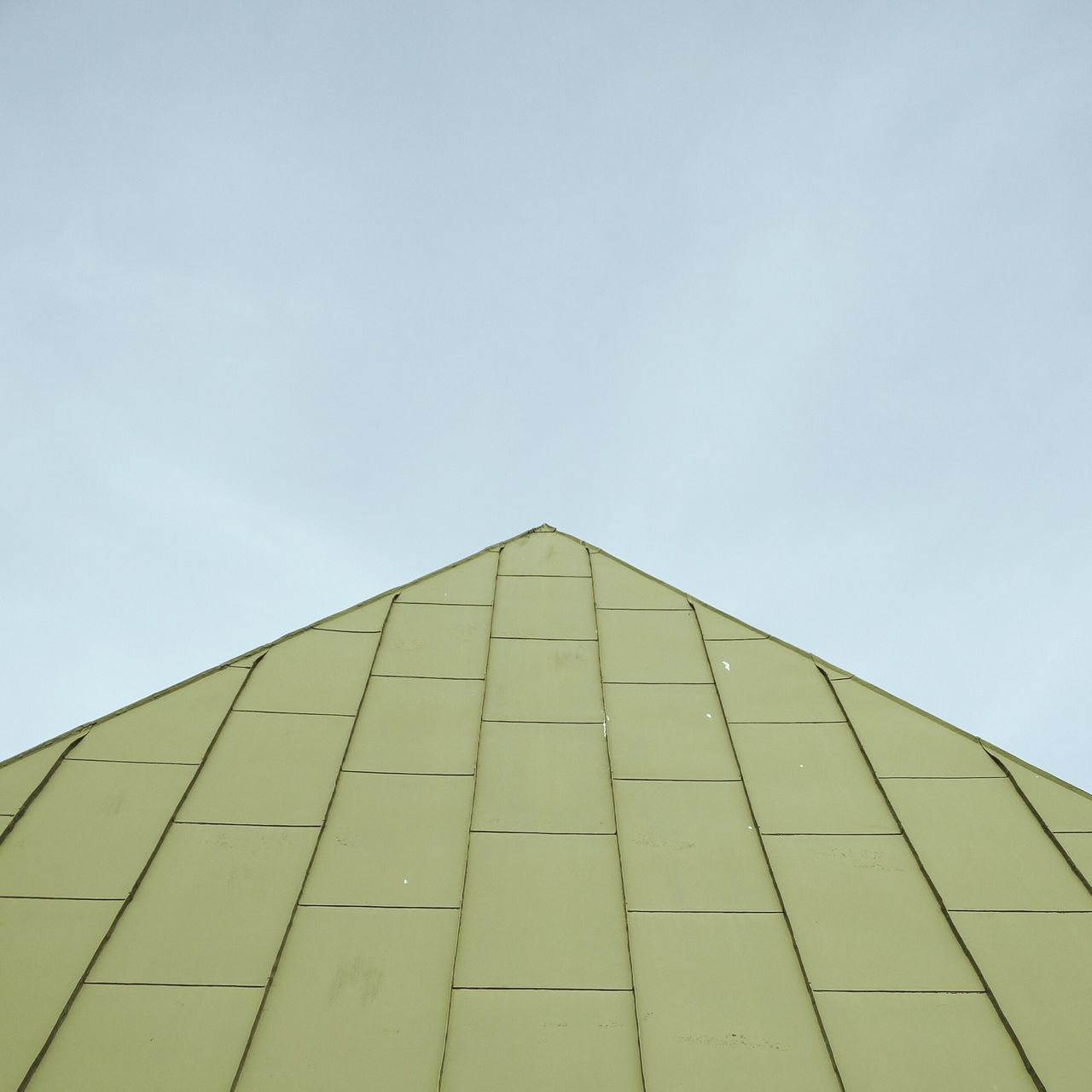 low angle view, built structure, architecture, triangle shape, day, no people, outdoors, sky, pyramid, building exterior, clear sky, modern
