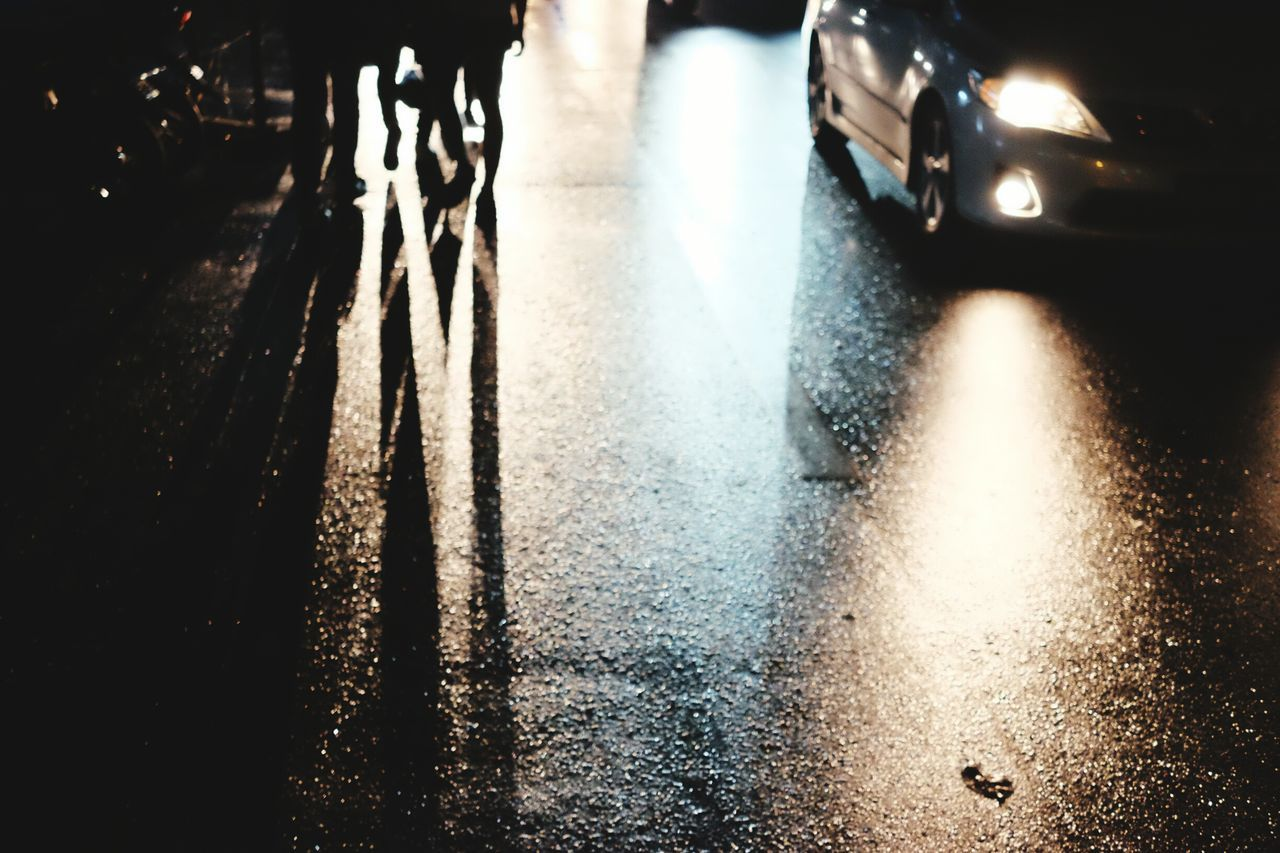 car, transportation, land vehicle, street, mode of transport, road, night, wet, outdoors, water, illuminated, no people, city, close-up