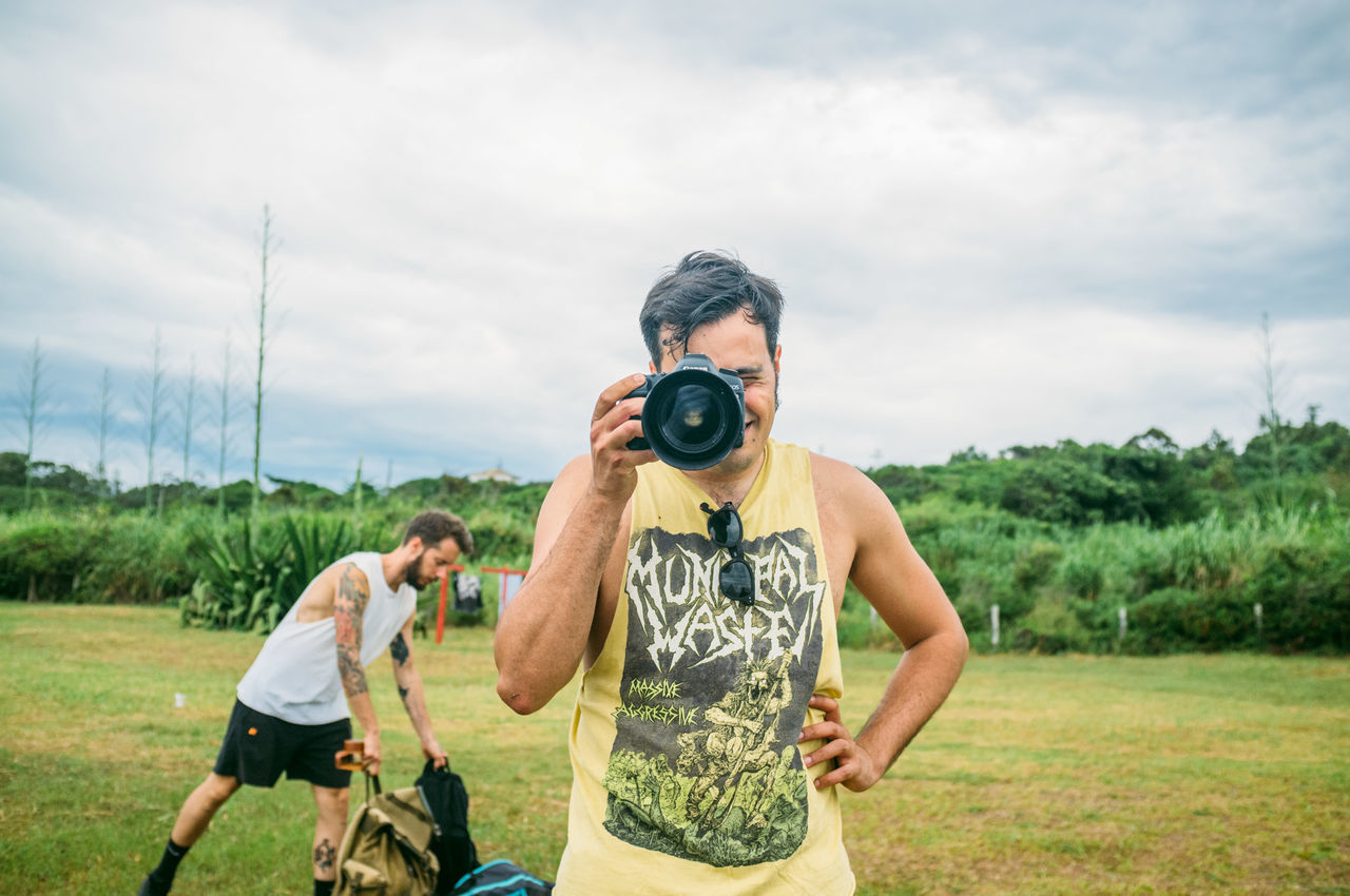 Adult Beach Brazil Camera - Photographic Equipment Casual Clothing Cloud - Sky Day Field Florianópolis Golf Course Grass Landscape Leisure Activity Men Mid Adult Men Nature Outdoors Photography Themes Real People Sky Smiling Standing Togetherness Tree Young Adult