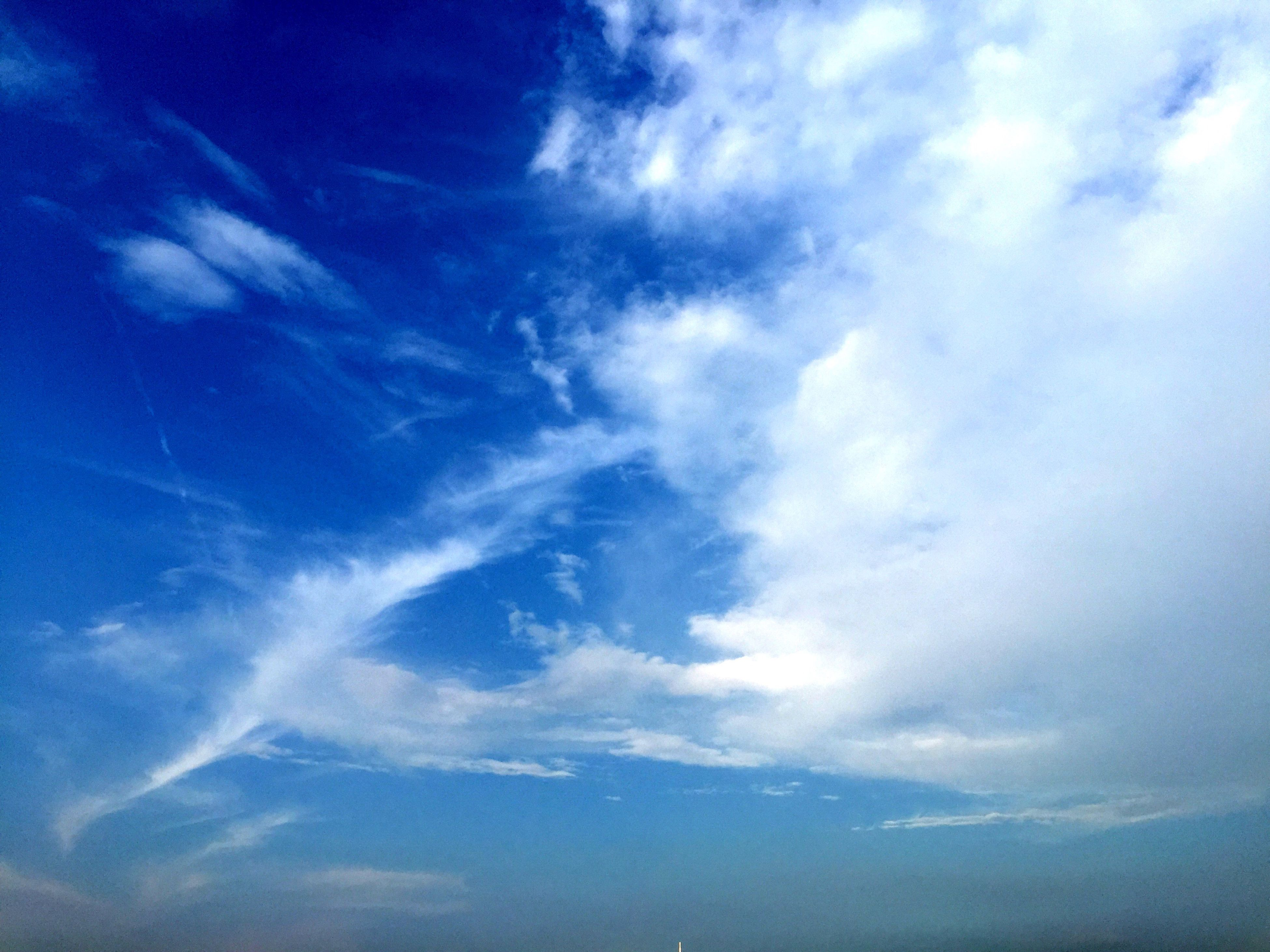 sky, low angle view, cloud - sky, blue, sky only, beauty in nature, tranquility, scenics, tranquil scene, nature, cloudy, cloudscape, cloud, backgrounds, idyllic, full frame, outdoors, no people, day, majestic