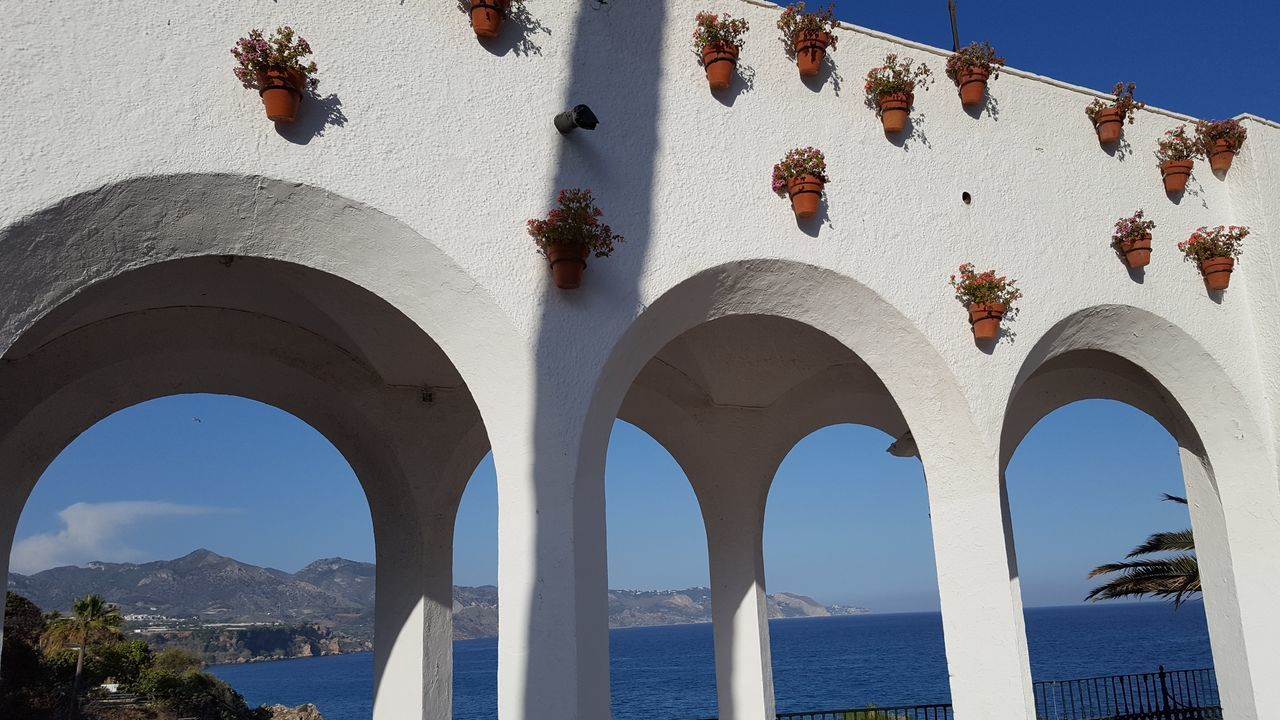 Arch Sunlight Ocean View Summer Mountain Range Sky Vacations Beach Water Scenics Travel Photography Arch Shape EyeEmNewHere Architecture Spain ♥ Live For The Story Travel Destinations Nerja Coast Costa Tropical Andalucia Spain Andalusia