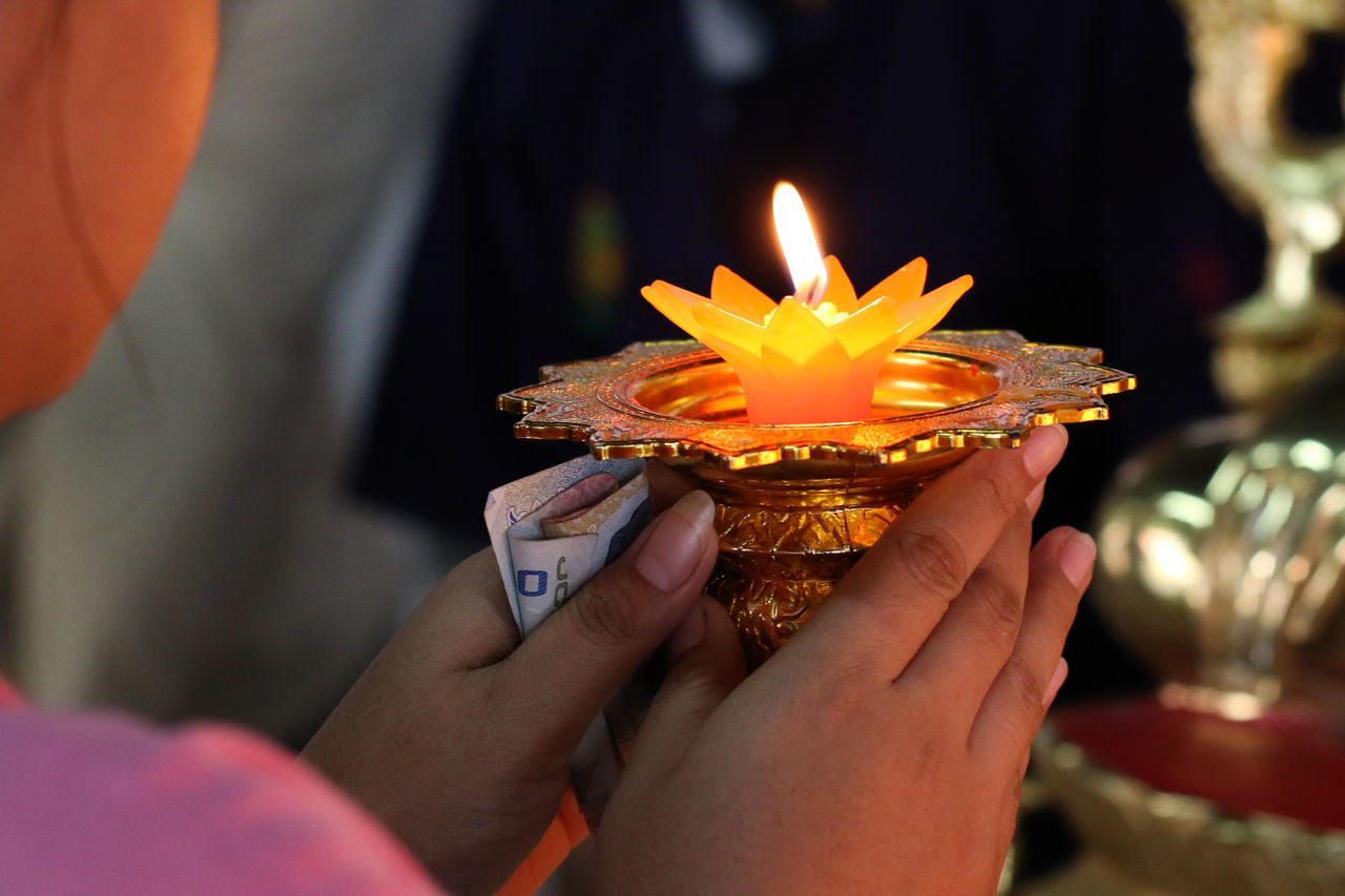 hand holding a burning candle Burning Candle Celebration Close-up Day Diwali Diya - Oil Lamp Flame Flower Focus On Foreground Heat - Temperature Holding Human Body Part Human Hand Illuminated Indoors  Lifestyles Men Oil Lamp One Person People Real People Religion Spirituality Women