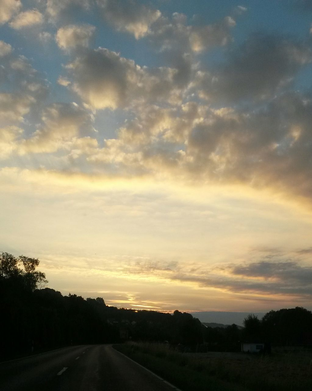 sunset, sky, cloud - sky, road, scenics, dramatic sky, no people, transportation, nature, tranquility, beauty in nature, tranquil scene, outdoors, landscape, the way forward, tree, day