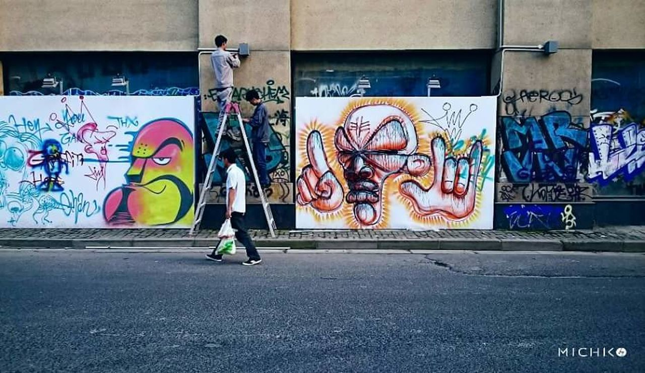 graffiti, creativity, art and craft, street art, artist, male likeness, human representation, real people, text, youth culture, men, multi colored, day, lifestyles, built structure, outdoors, architecture, breakdancing, city, one person, musician, adult, only men, people