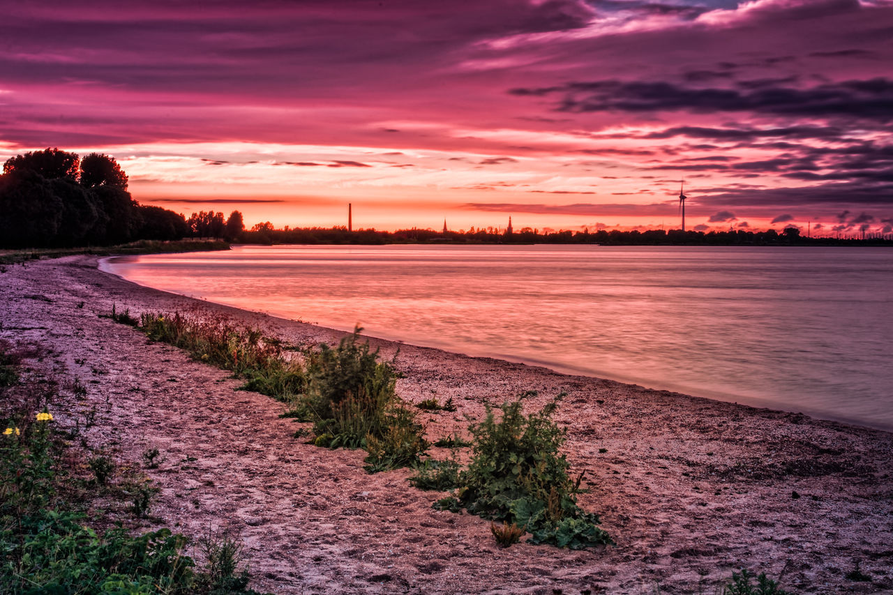 Footsteps In The Eveningsun Beauty In Nature Cloud - Sky Landscape No People Outdoors Romantic Sky Scenics Sky Sunset Tranquil Scene Water