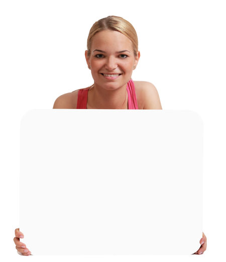 Young fit woman holding a white placard,isolated against a white background. Copy Space Isolated White Board Woman Adult Anouncement Blank Female Fit Fitness Isolated White Background One Person People Person Smile Smiling White Backgroud White Background White Placard Young Adult Young Woman Young Women
