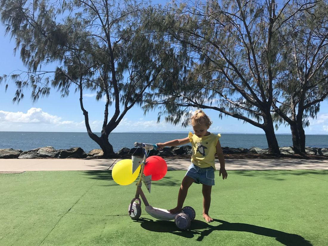 Full Length Sea Playing Beach Day Sport Leisure Activity Weekend Activities Children Photography Tree Togetherness Childhood Child Birthday Party By The Sea Nature Balloons One Person Scooterfun Bright Colours Outdoors