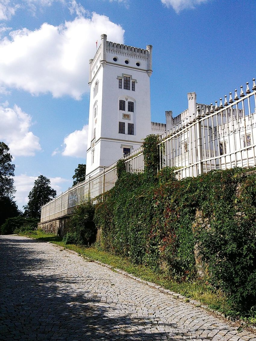 White Castle Architecture Building Tower White Tower White Castle Historical Building Moravia Moravian Castle Moravian Architecture Fence Greenery Green Color Pathway Cobblestone Cobblestone Path Behind The Fence White Color White Building Architektur Architecturelovers Sunny Day Not Selected For Market Blue Sky