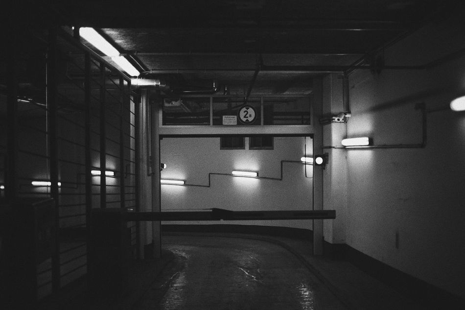 Night. The City Light Indoors  Illuminated Empty Lighting Equipment Parking Garage Artificial Mono No People Architecture Monochromatic Monochrome Photography Monochrome Black & White Black And White Blackandwhite Night Photography Neon Lights City Nightphotography Night Lights The Week Of Eyeem 35mm Streetphotography Mood