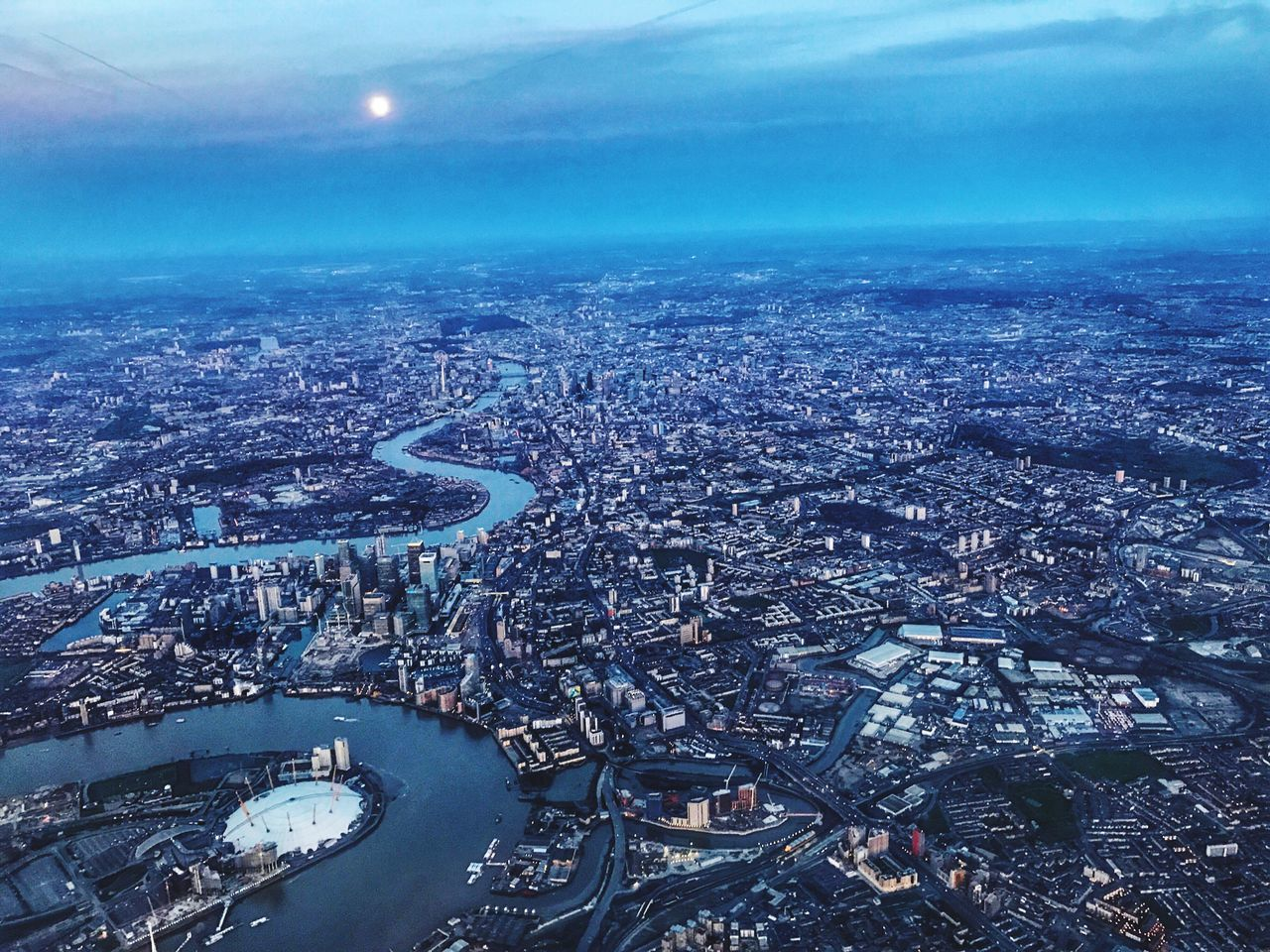 cityscape, city, aerial view, architecture, building exterior, built structure, crowded, sky, river, outdoors, city life, transportation, day, landscape, road, travel destinations, nature, scenics, skyscraper, urban skyline