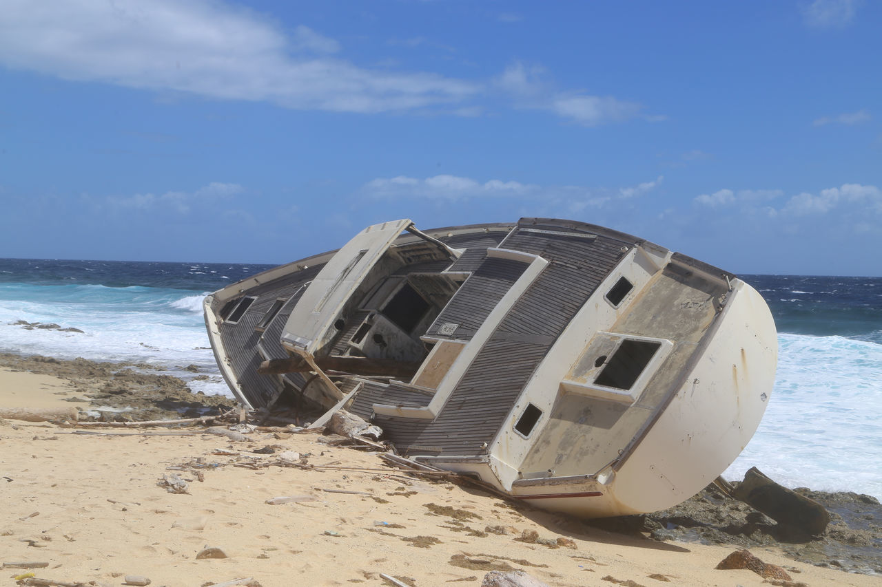 Beach Coastline Damaged Day Dry Dock Horizon Over Water Obsolete Outdoors Ruined Sand Sea Shore Side Ways Sky Stranded Stranded Boat Tranquil Scene Water Wave Wreck Wrecked