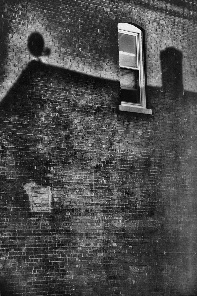 """There are men whom one hates until a certain moment when one sees, through a chink in their armour, the writhing of something nailed down and in torment."" - Gerald Kersh Noir Blackandwhite Brick Building Brick Wall BOB Brick Old Building Shadows Shades Of Grey Window Dark Mood Somber Urbex Streetphotography Night Urban Landscape"