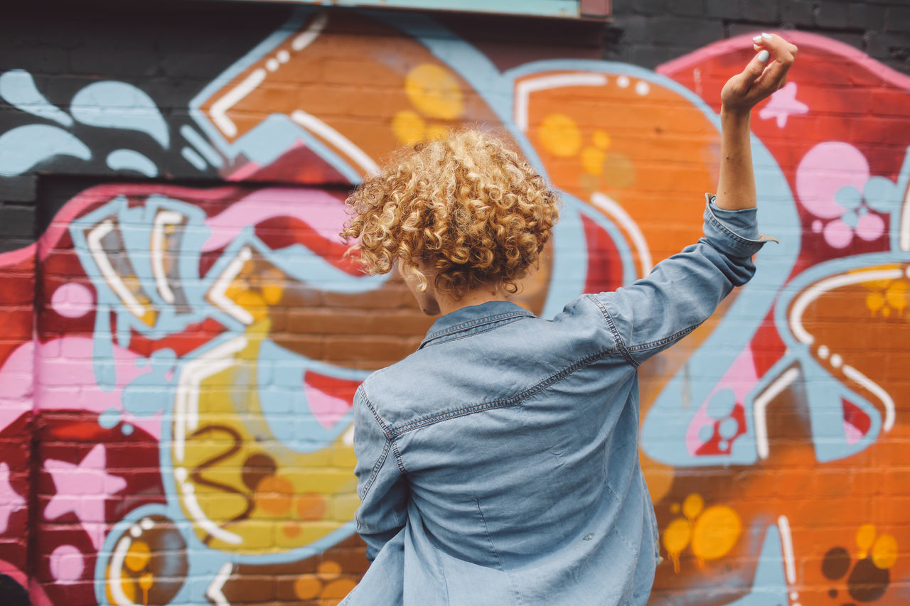 Beautiful stock photos of graffiti, 30-34 Years, Architecture, Arms Raised, Art And Craft