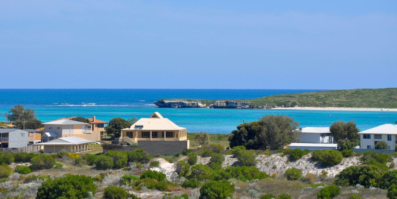 Seaside living with the Indian Ocean waters and neighbourhood on the waterfront in Lancelin, Western Australia. Architecture Beach Beauty In Nature Blue Community Horizon Over Water Housing Indian Ocean Lancelin Landscape Lifestyle Living Luxury Nature Neighborhood Oceanside Outdoors Scenics Sea Seascape Seaside Sky Tree Water Western Australia