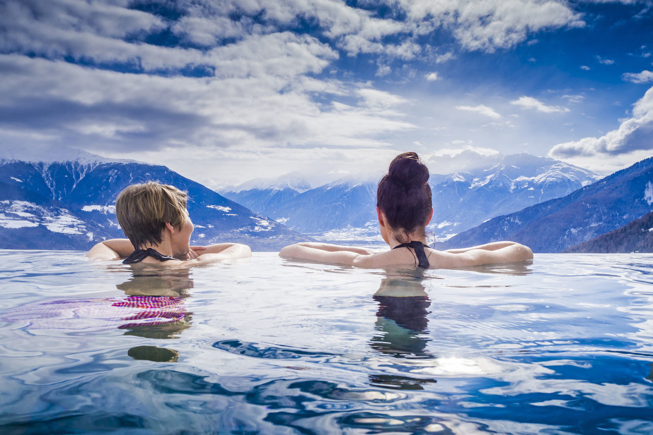 Women enjoying the view from the infinity pool Alps Austria Friendship Girlfriends Holiday Hotel Infinity Pool Leisure Activity Lifestyle Luxury Meran Mountain Range Panorama Pool Recreation  Spa Swimming Swimming Pool Togetherness Travel Two People Unfiltered Vacations Water Women