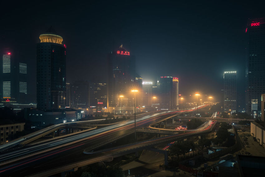 Beijing's Guomao intersection CBD Dark Guomao Overpass Architecture Building Exterior Built Structure City City Life Cityscape Dystopian High Angle View Illuminated Light Trail Night No People Road Skyscraper Speed Traffic