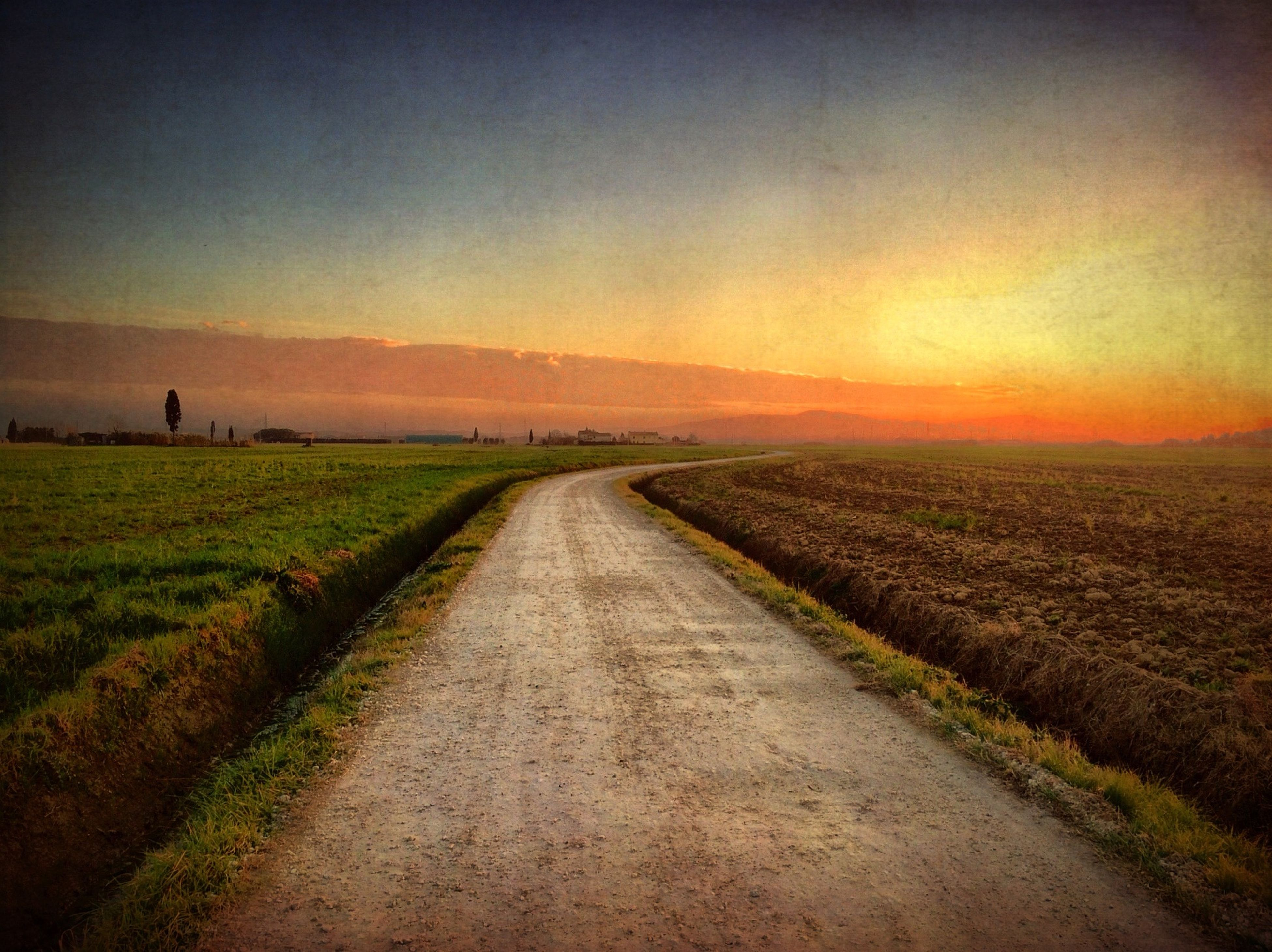 the way forward, landscape, sunset, tranquil scene, field, tranquility, diminishing perspective, rural scene, scenics, vanishing point, beauty in nature, nature, sky, country road, grass, road, dirt road, agriculture, horizon over land, orange color
