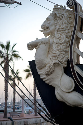 """Alicante, Spain- February 24, 2016: Bow of the """"Santisima Trinidad"""" ship. Ship is an exact replica of the """"Santisima Trinidad"""". It took over 2 years to build and cost more than 4 million Euros. Alicante, Costa Blanca. Spain Alicante, Spain Bow Costa Blanca Decorative Detail Europe Forecastle Galleon Harbor History Landmark Lion Marine Nautical Vessel Old-fashioned Outdoors Part Of Replica  Retro Styled Santisima Trinidad Sculpture Ship SPAIN Tourist Attraction  Travel Destinations"""