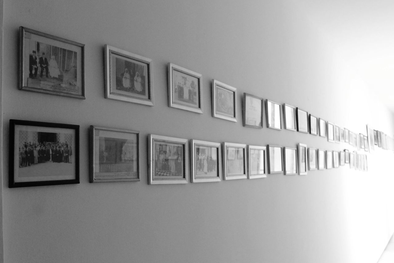 Long way of Images on the wall Picture Frame Photograph Indoors  No People Illuminated Architecture Black And White Day EyeEm Best Shots EyeEm Gallery Wall Frame