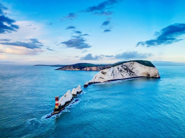 The Needles Isle of Wight.. Sea Blue Sky Beauty In Nature Water Cloud - Sky Tranquil Scene Scenics Idyllic Outdoors Nautical Vessel Nature Tranquility Beach Dji Drone  UK Landscape Photooftheday UK 🇬🇧 Tranquility Isleofwight Aerial View Geology Sea And Sky Sunset
