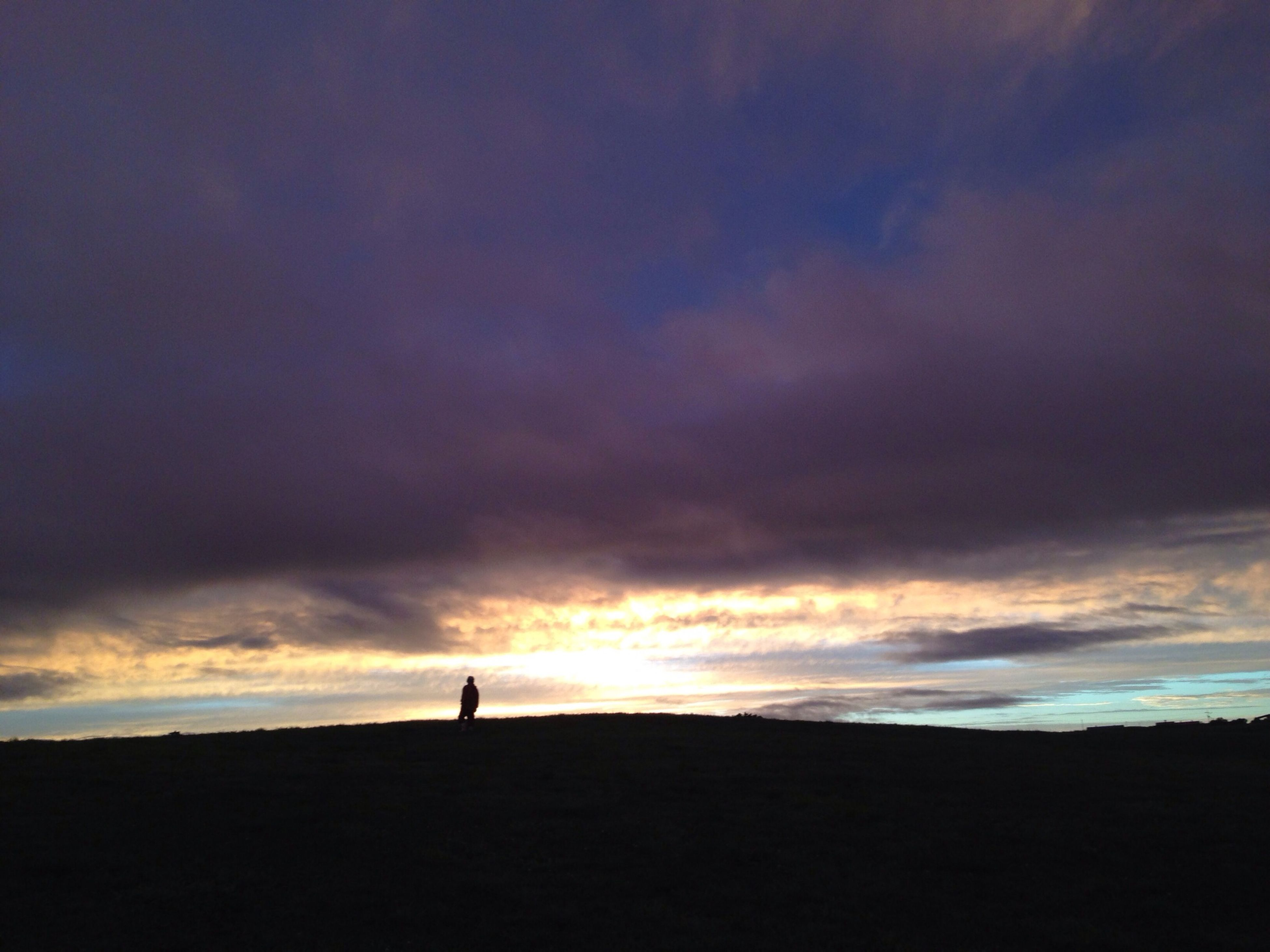 silhouette, sky, sunset, cloud - sky, tranquil scene, scenics, tranquility, beauty in nature, cloudy, cloud, landscape, nature, dramatic sky, dusk, idyllic, outline, orange color, standing