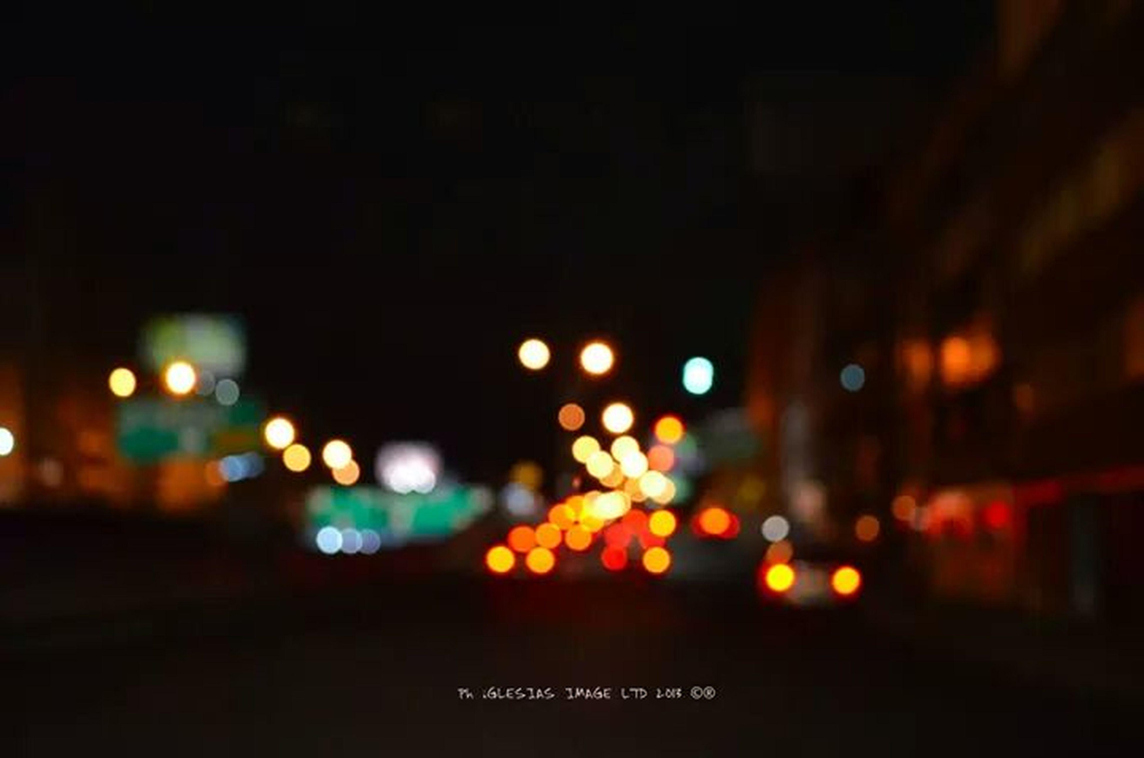illuminated, night, defocused, city, lighting equipment, light - natural phenomenon, building exterior, street, transportation, street light, no people, dark, built structure, architecture, road, outdoors, city life, car, glowing, sky