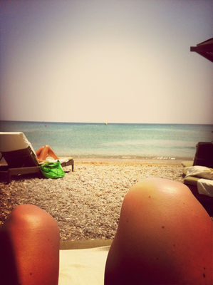 Getting a tan at Doryssa Seaside Resort Hotel Samos by Linda
