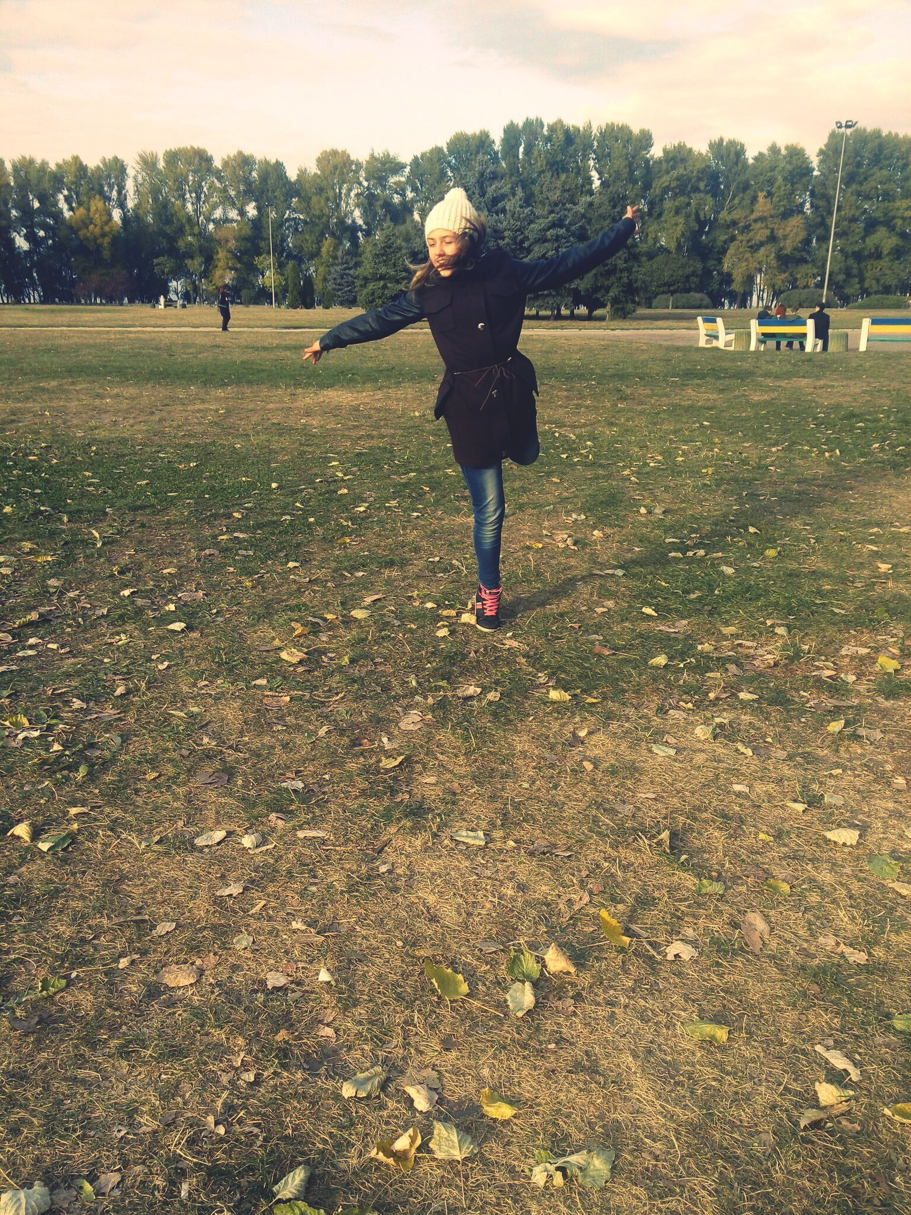 full length, lifestyles, leisure activity, casual clothing, standing, tree, field, person, childhood, rear view, landscape, sky, girls, park - man made space, young adult, walking, elementary age, nature