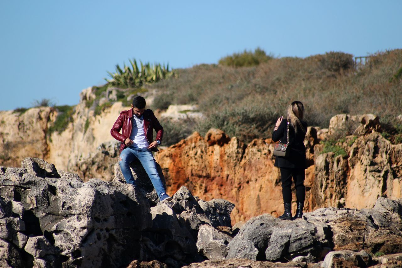 Casual Clothing Cliff Couple Elegant Exceptional Photographs Friendship From My Point Of View Grass Holding Men Nature Outdoor Pursuit Outdoors People People And Places Peoplephotography Person Plants Rock Rocky Rocky Mountains Sky Taking Pictures Uniqueness Woman