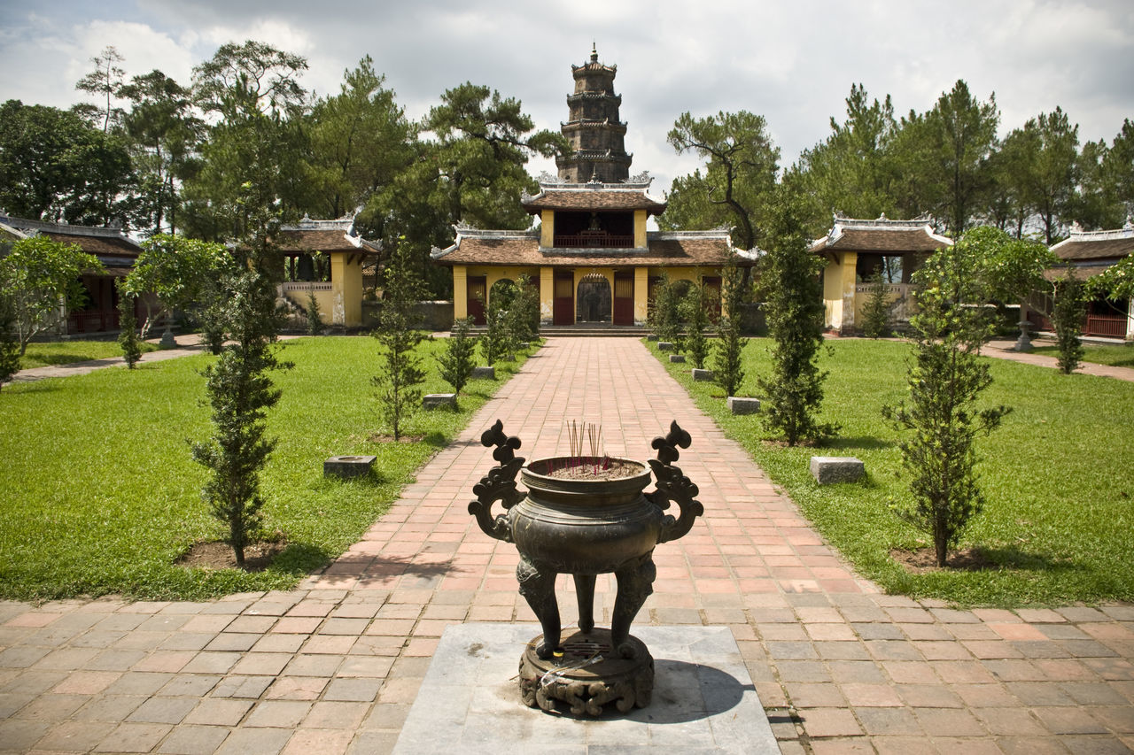 Architecture Art Art And Craft Buddhism Buddhist Temple Building Exterior Built Structure Check This Out Cloud - Sky Cobblestone Footpath Formal Garden Grass Harmony Meditation Pagoda Pagode Park - Man Made Space Peace Sculpture Statue ThienMupagoda Tranquility Tree Vietnam