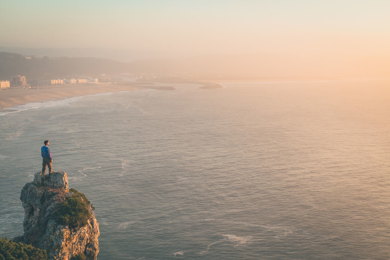 Beauty In Nature Cliff Day Destination Holiday Mountain Nature Nature Nazare Portugal Nazaré  Ocean View On The Edge Orange Outdoors Rock Scenics Sea Sky And Clouds Standing Sunset Travel Destinations Trip Vacation View Water