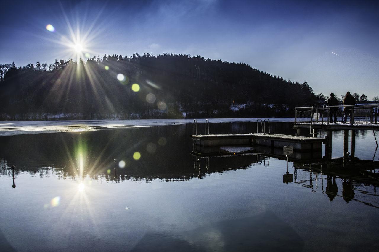 Beauty In Nature Ice Illuminated Lake Nature No People Outdoors Reflection Shiny Sky Sun Tranquility Tree Water