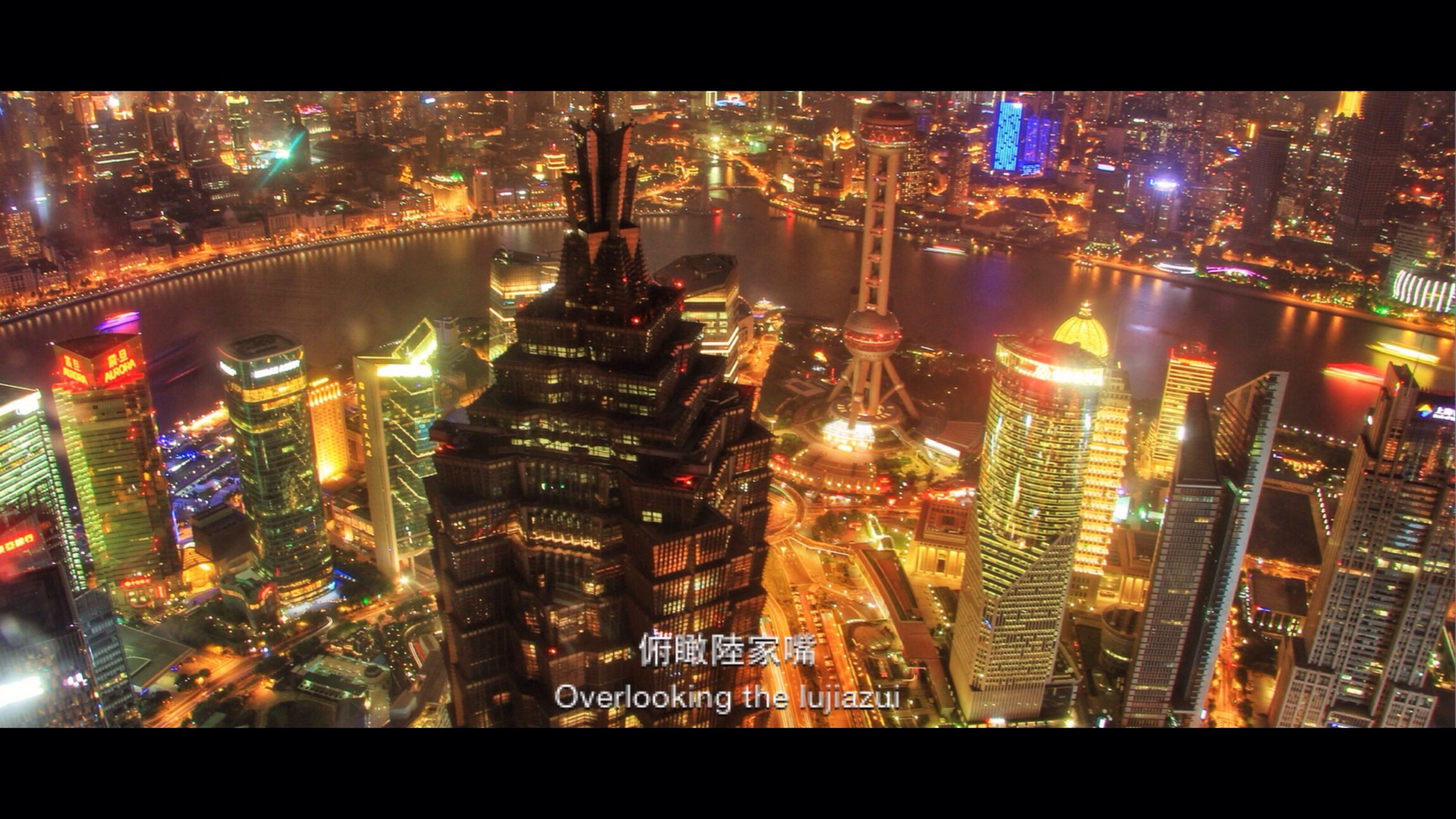 illuminated, night, city, architecture, building exterior, cityscape, built structure, skyscraper, transfer print, modern, crowded, tall - high, tower, office building, city life, financial district, water, reflection, capital cities, high angle view