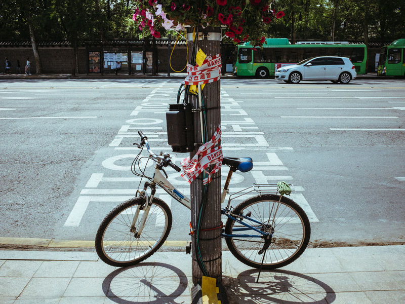 Bicycle Bicycle Rack Car City Day Land Vehicle Mode Of Transport No People Outdoors Parking Road Stationary Street Transportation Tree