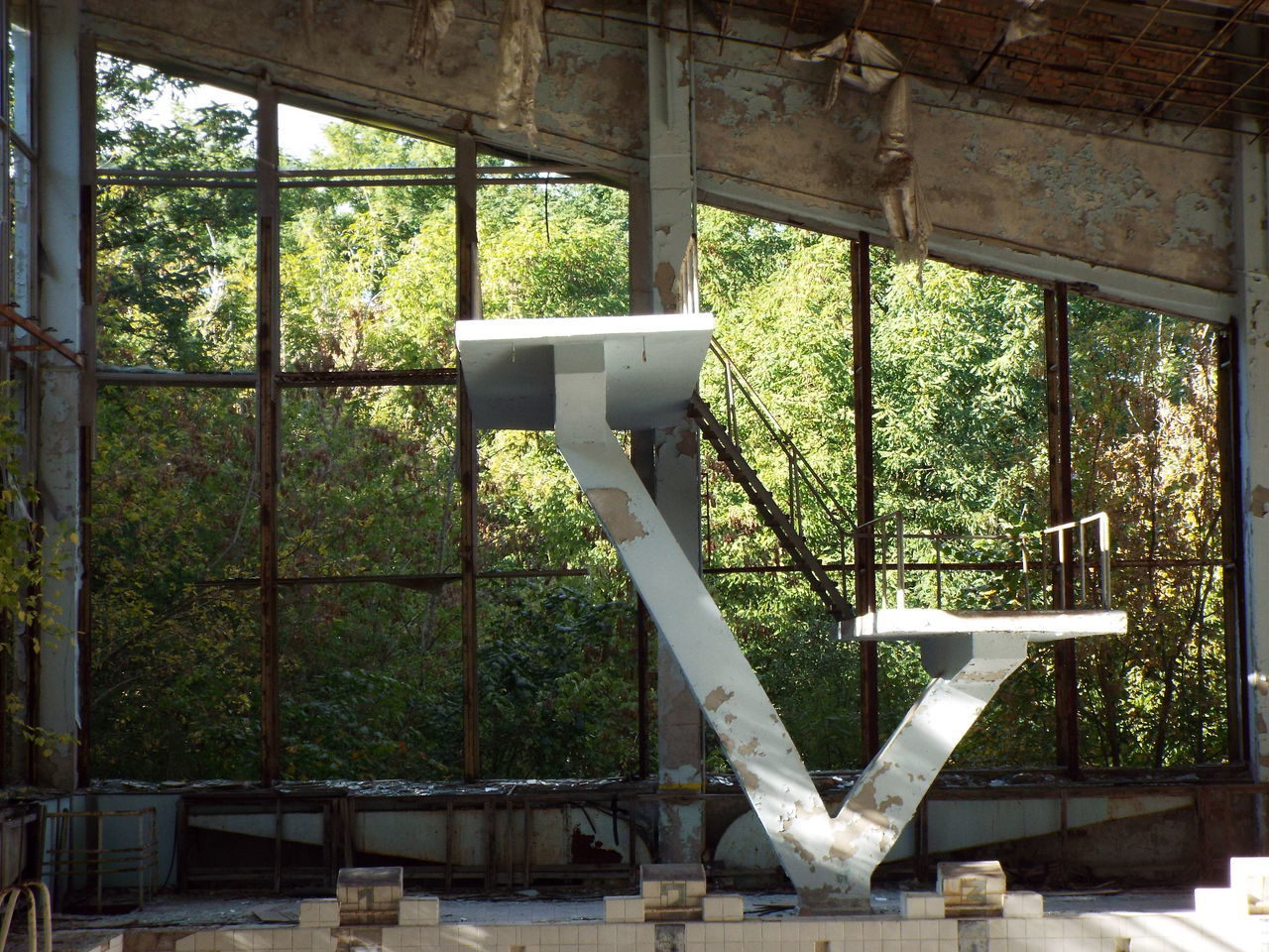 Image captured at the abandoned swimming pool in Chernobyl, Ukraine. The area has been left to ruin since 1986. The swimming pool was still being used days after the disaster. Abandoned Chernobyl Diving Board Nuclear Disaster Ruins Sports Center Swimming Pool Ukraine Chernobyl Exclusion Zone Chernobyl Town Chernobyl Zone