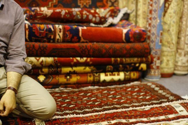 Persian Carpet & Rug Rugs Carpets Retail  Salesman Bazaar Marketplace Business Middle East Gulf Countries Live Love Shop Investing In Quality Of Life