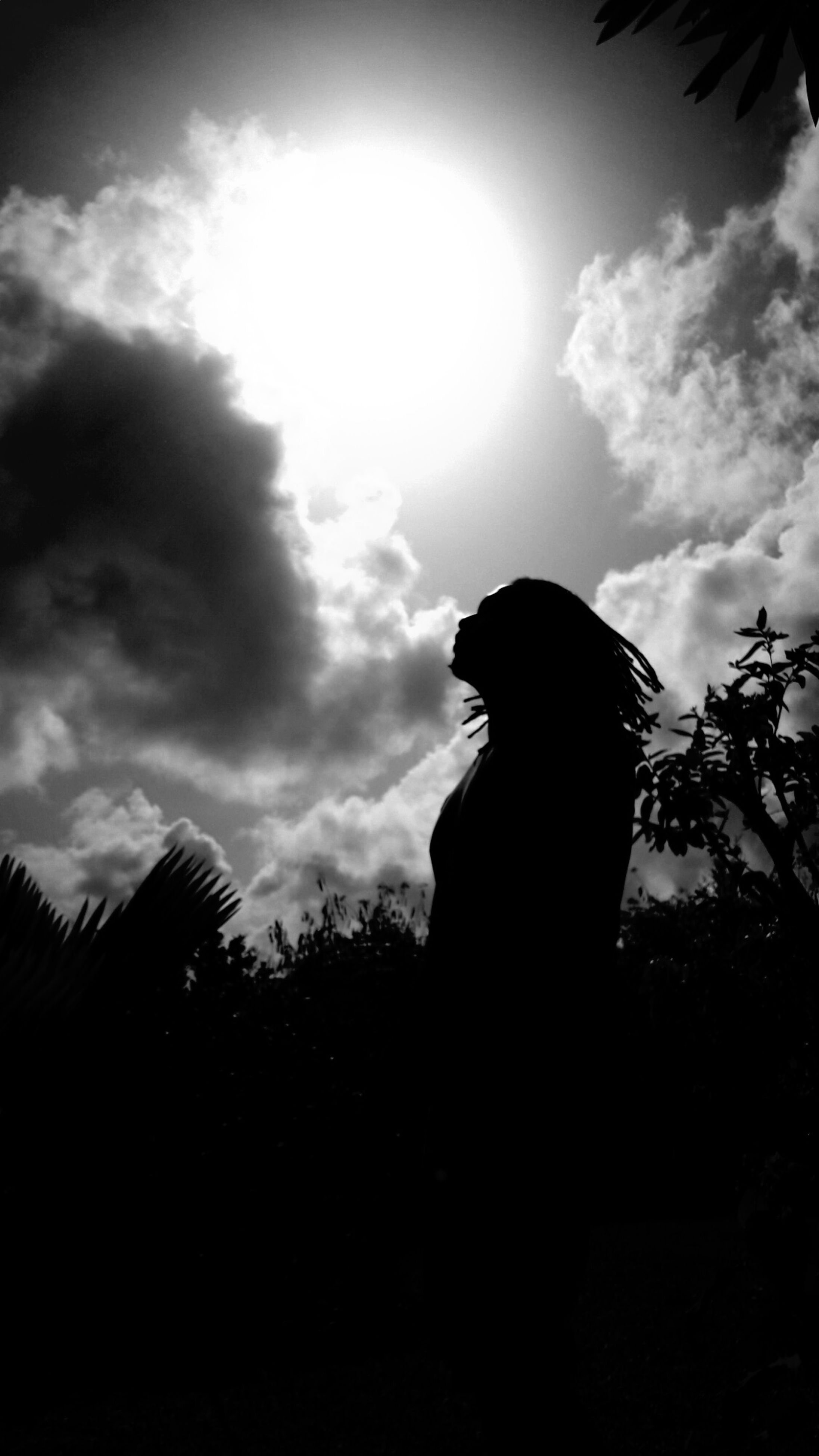 silhouette, sky, real people, one person, cloud - sky, lifestyles, leisure activity, standing, women, low angle view, outdoors, men, nature, day, people