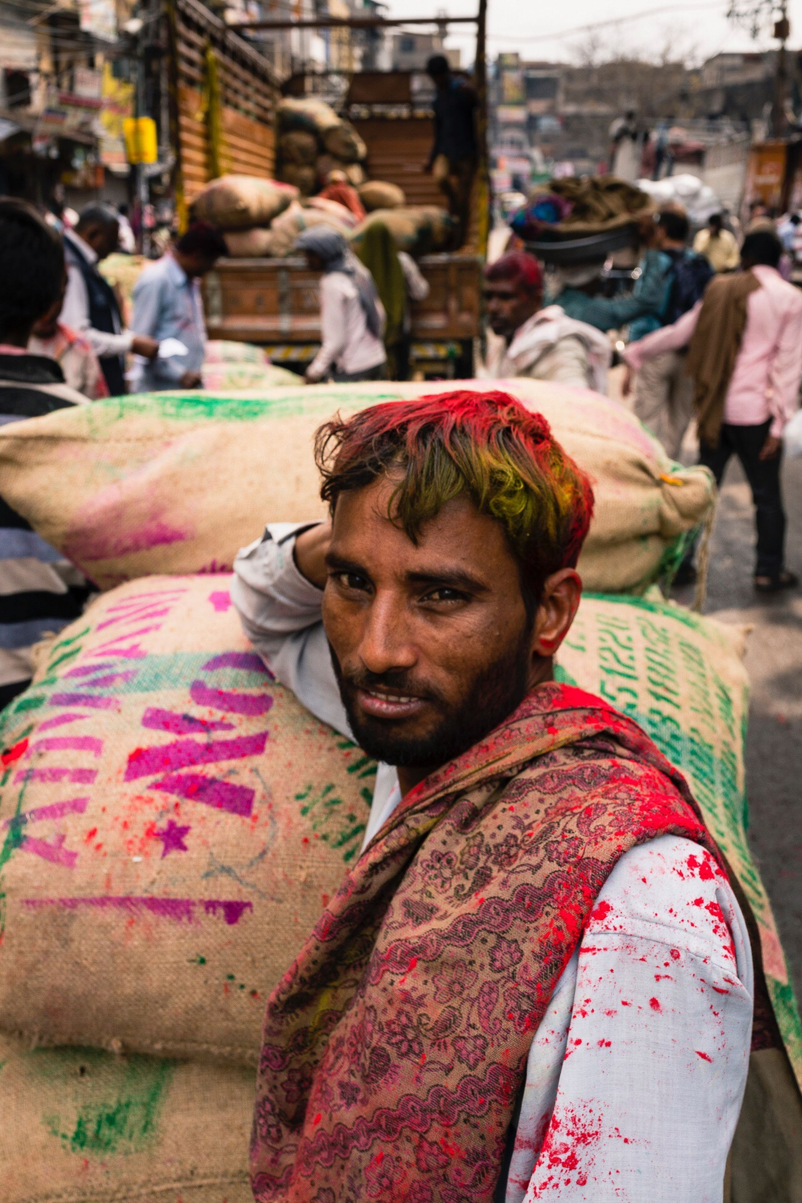 real people, incidental people, focus on foreground, one person, holi, traditional clothing, lifestyles, sitting, outdoors, day, powder paint, men, turban, mammal, close-up, adult, people, adults only