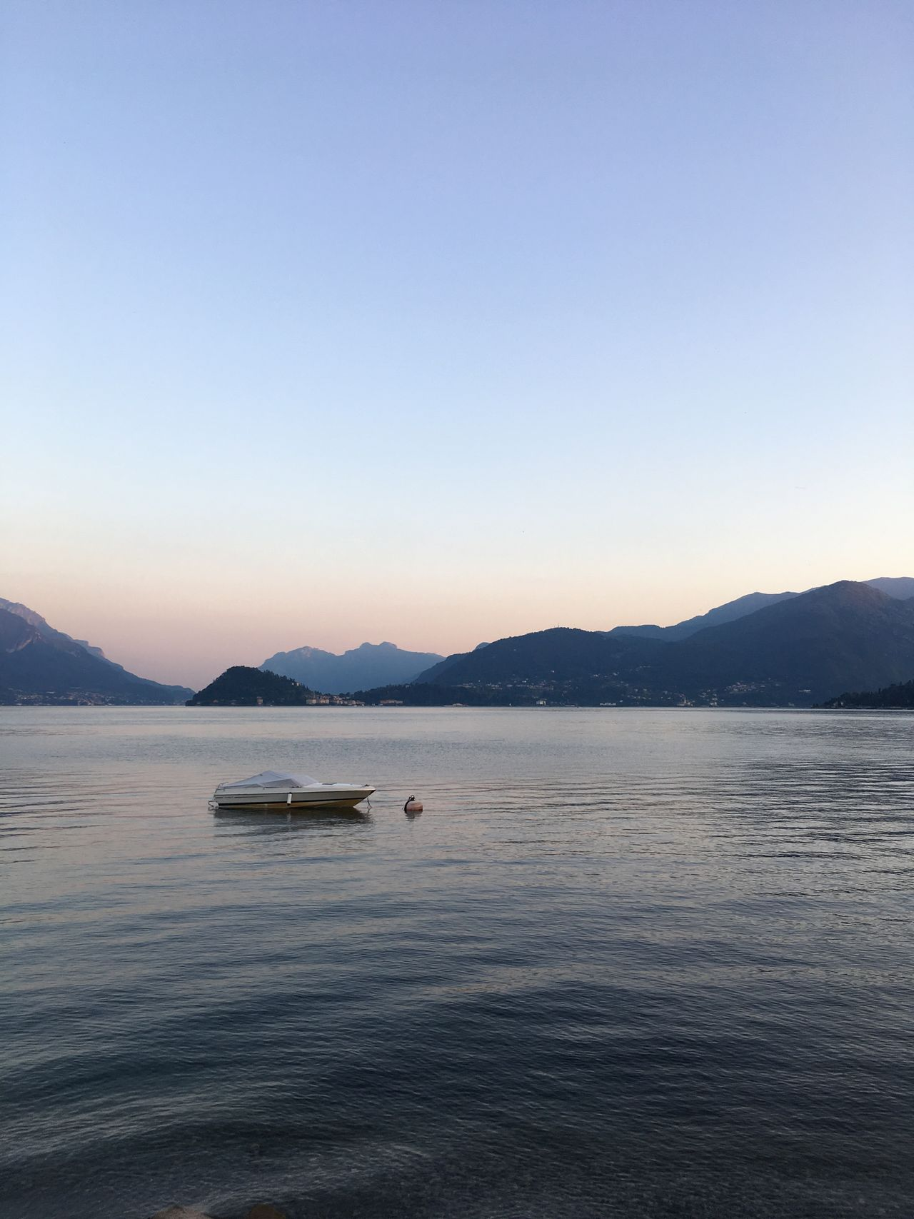 Mountain Copy Space Clear Sky Water Waterfront Nautical Vessel Mountain Range Transportation Tranquil Scene Sunset Boat Scenics Tranquility Dusk Beauty In Nature Calm Blue Nature Sea Non-urban Scene Lakecomo Italy Carefree Tourism Travel