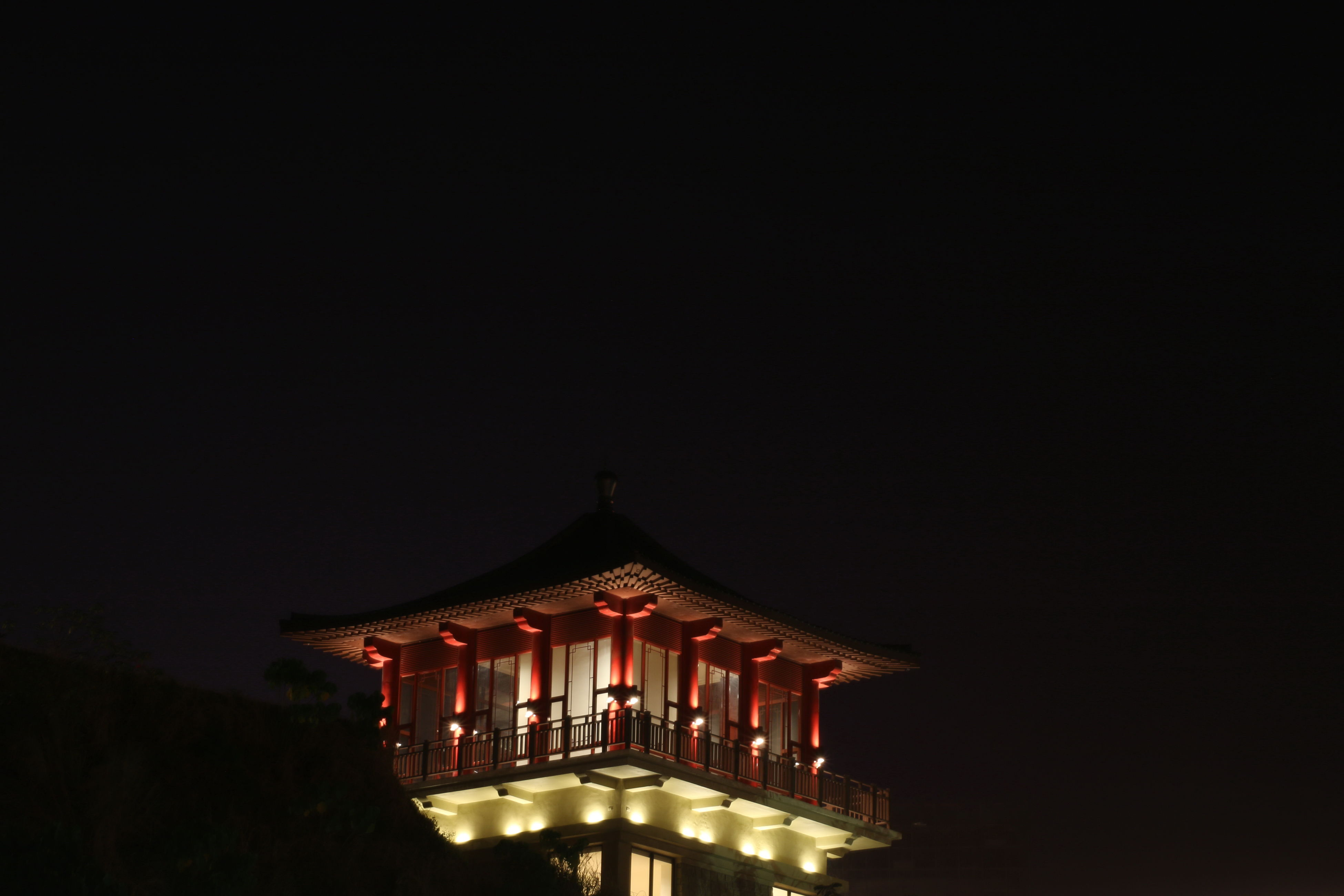 architecture, built structure, building exterior, low angle view, place of worship, copy space, religion, clear sky, spirituality, night, temple - building, illuminated, history, sky, high section, outdoors, no people, tradition, building