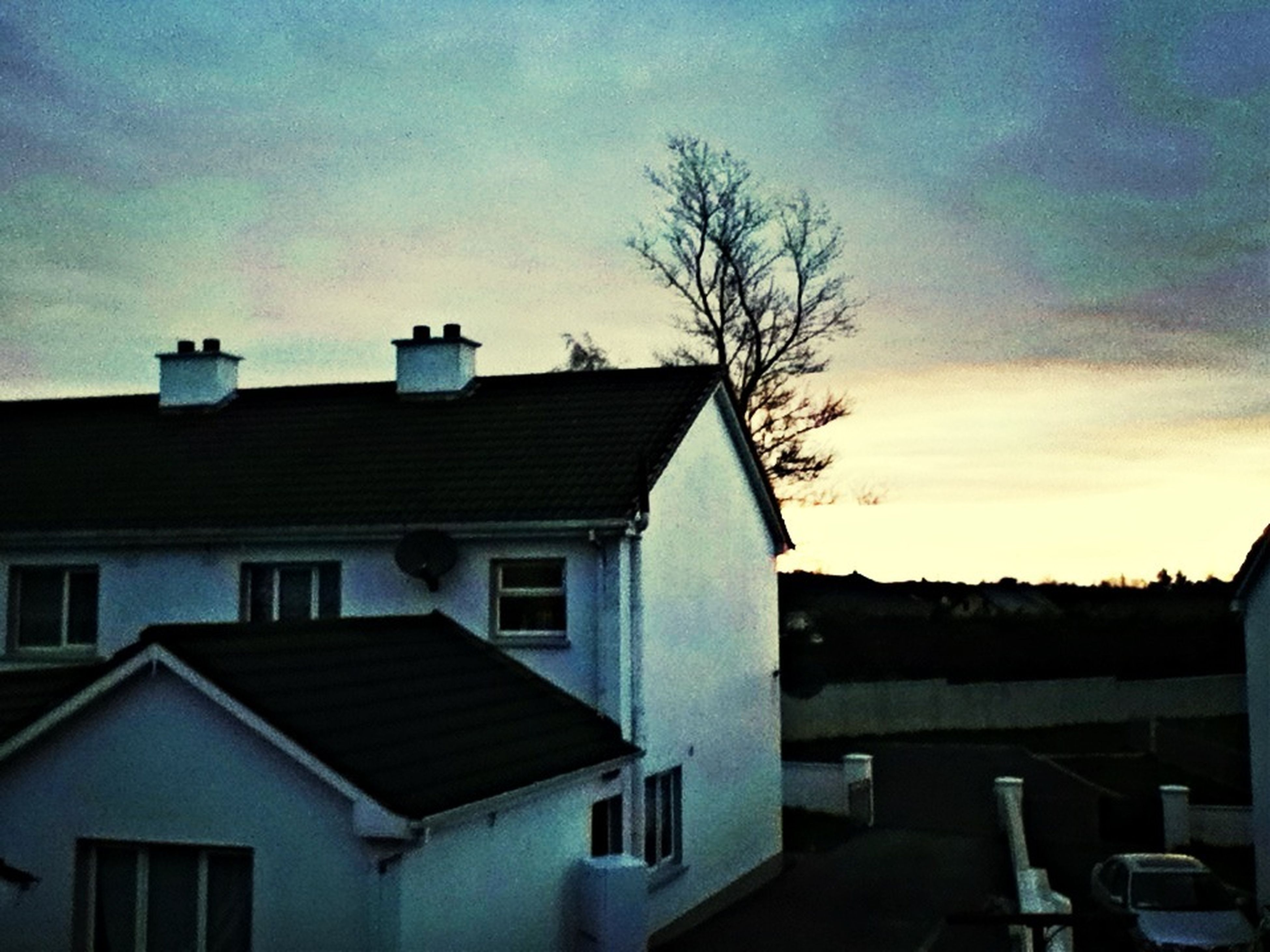 building exterior, architecture, built structure, house, sky, roof, residential structure, residential building, cloud - sky, cloud, tree, low angle view, window, outdoors, no people, sunlight, town, building, day, nature