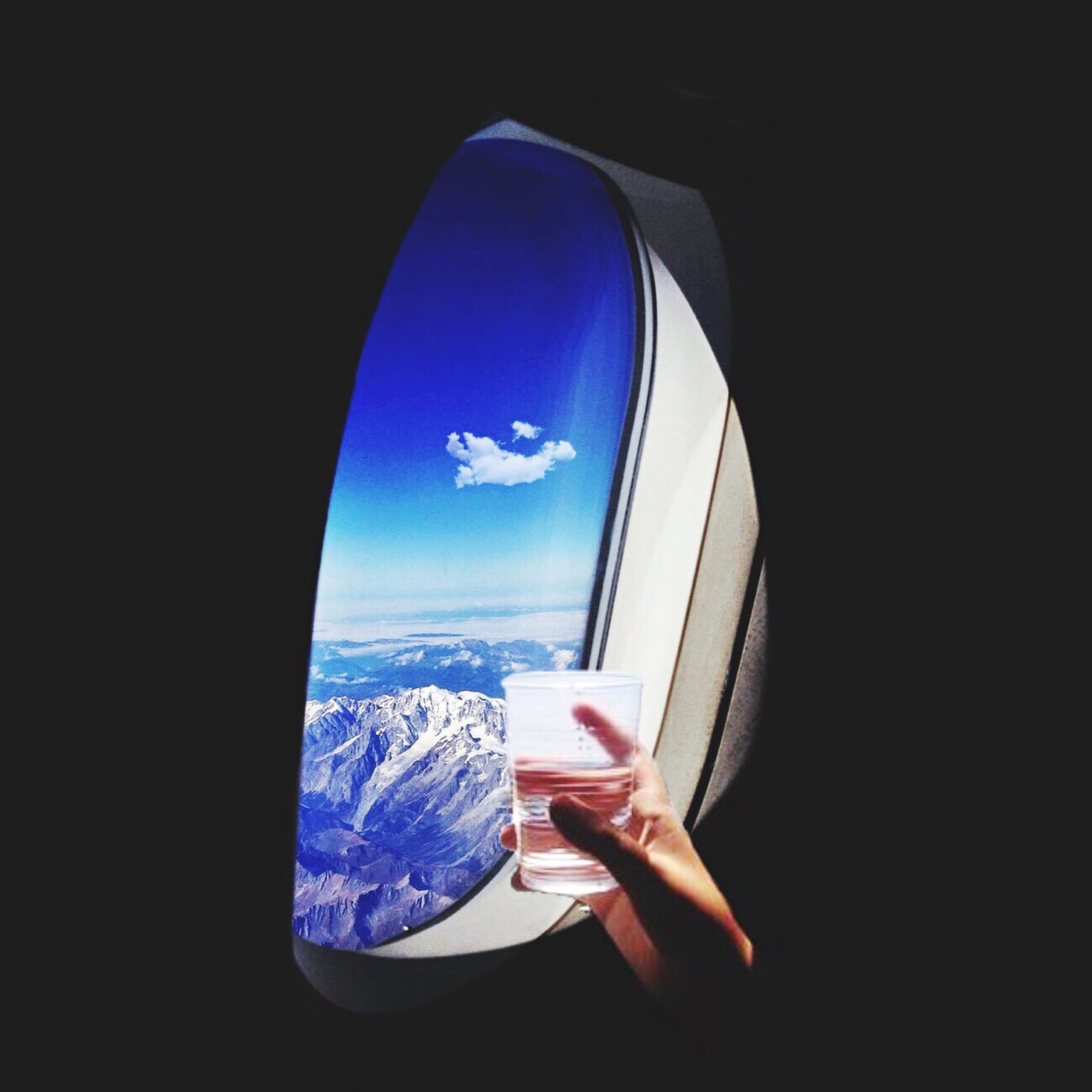 transportation, mode of transport, airplane, air vehicle, window, flying, part of, vehicle interior, reflection, blue, glass - material, mid-air, travel, transparent, cropped, sky, journey, close-up, fish-eye lens, one person
